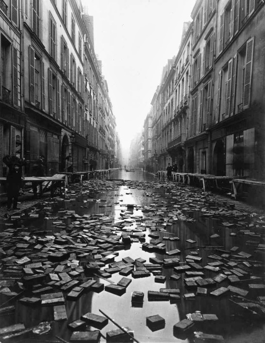 Books float on the street after a library on Rue Jacob, Paris is flooded during the Great 1910 Parisian Flood